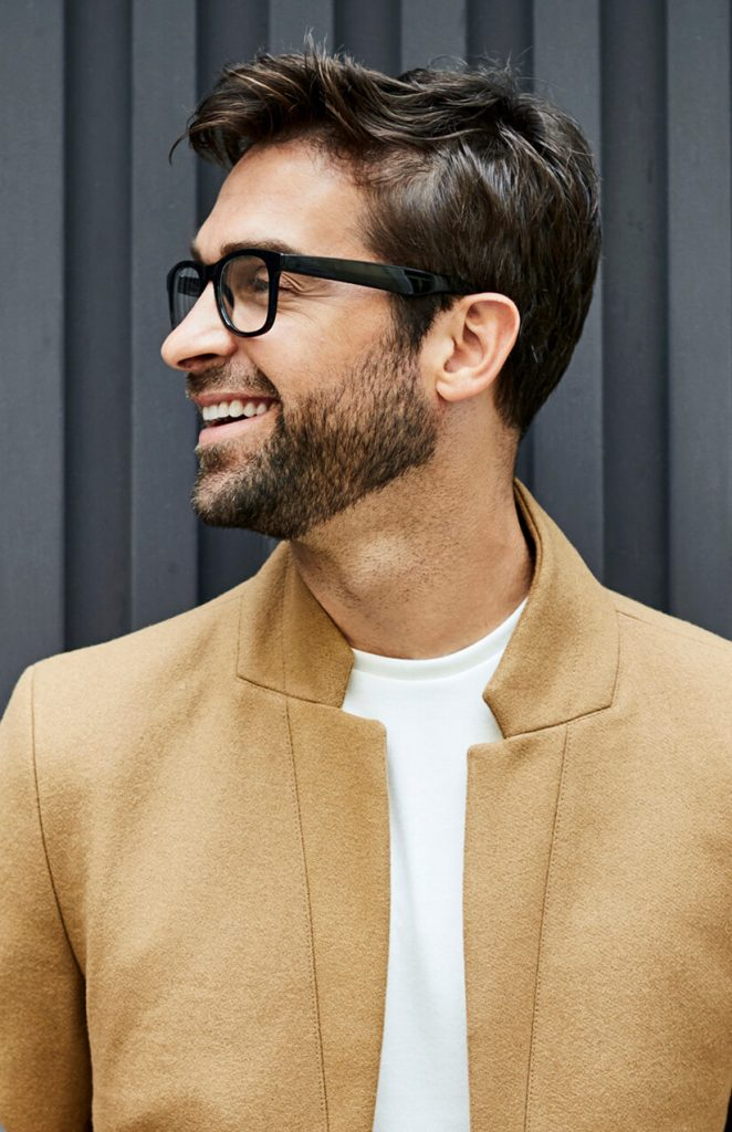 Smiling man with new eyeglasses